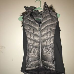 Michael Kors green vest with a fur  hoodie